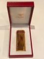 Зажигалка Cartier позолоченная